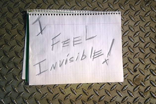 I feel invisible written on notepad